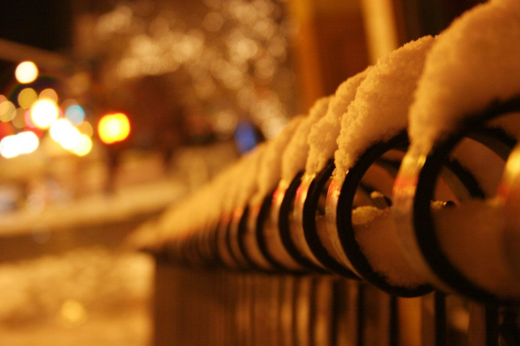 snow on railing - holiday injury lawsuits