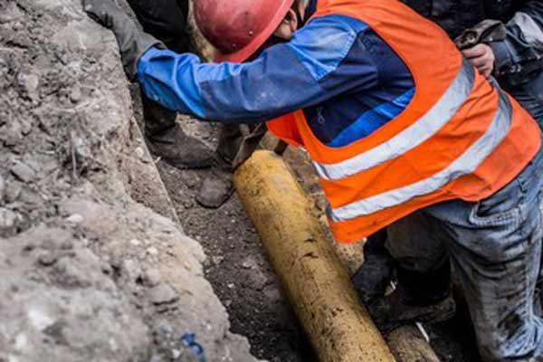 natural gas utility crew repairs pipeline